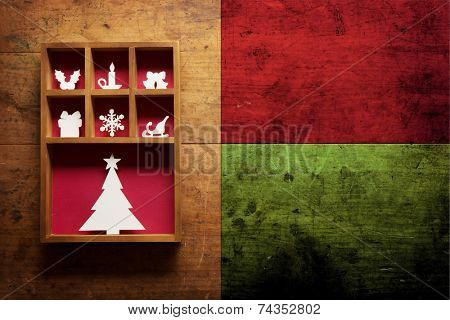 Christmas decoration on a old grungy wooden surface, with plenty of copy space.   Paper Christmas decoration (hand cut) in a wooden display tray.