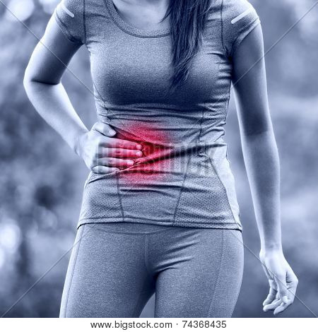 Side stitch - woman runner side cramps after running. Jogging woman with stomac side pain after jogging work out. Female athlete. poster