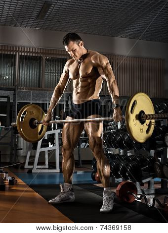 very power athletic guy bodybuilder execute exercise with weight in the standing position poster