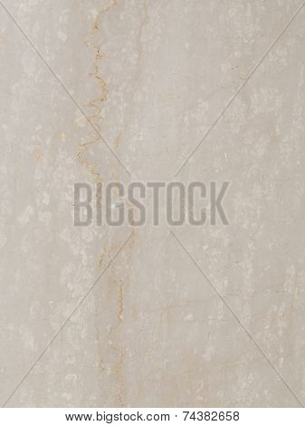 large slab of solid smooth beige marble with brown streaks and spots of light and dark poster