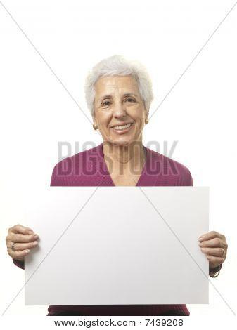 Attractive Senior Woman Holding Blank Billboard