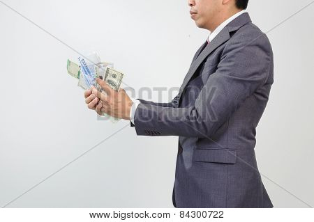 Man In Suit Holding Knife And Korean Won