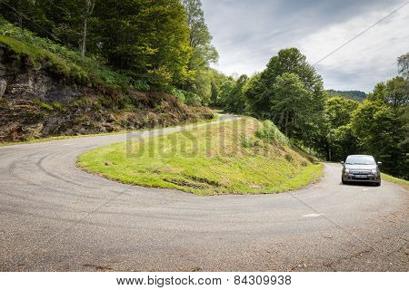 Fiat 500 Driving Up A Winding Road