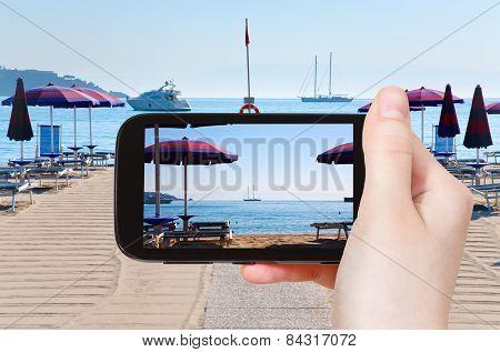 Tourist Taking Photo Of Sand Beach Giardini Naxos