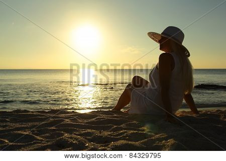 Woman Looking Into The Sunset