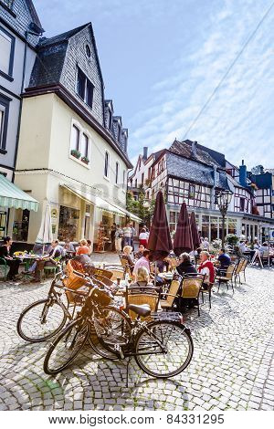 People Enjoy The Summer Day At Market Place