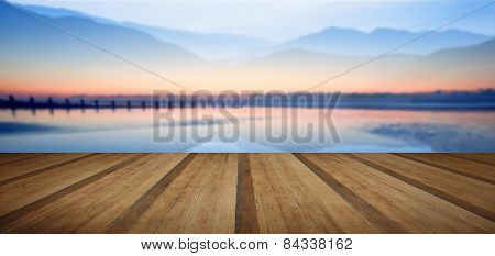 Double Exposure Technique Effect Of Mountains And Sunrise Beach Landscape With Wooden Planks Floor