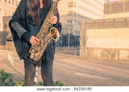Beautiful Young Woman Playing Tenor Saxophone