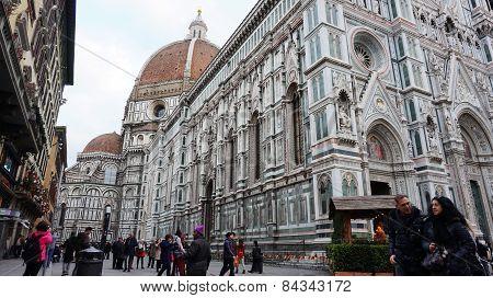Tourists Visit Basilica Di Santa Maria Del Fiore In Florence