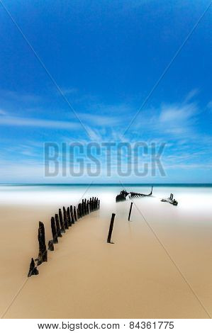 Ship wreck of SS dicky under the moon lit sky in Queensland, Australia.