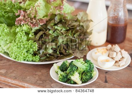 Fresh Hydroponic Vegetables On Wooden Table