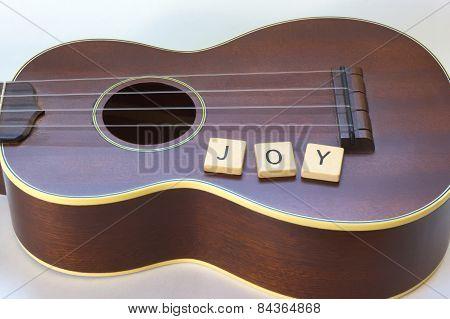 Ukulele Joy with wooden Letter Tiles