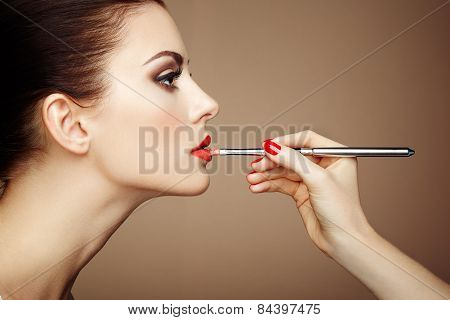 Makeup Artist Applies Lipstick