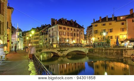 Palais de l'Ile jail, Perriere bridge and canal in Annecy old city, France, HDR