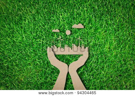 Paper cut of  eco friendly city on grass