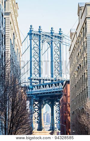 Manhattan Bridge, framed by brownstones, as seen from Brooklyn, New York City, USA