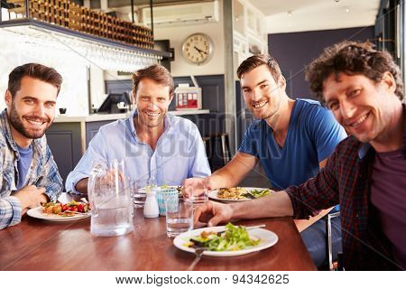 A group of men having lunch in a restaurant poster