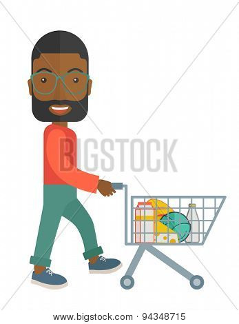 A black male shopper pushing a shopping cart inside the supermarket. A contemporary style. Vector flat design illustration with isolated white background. Vertical layout.