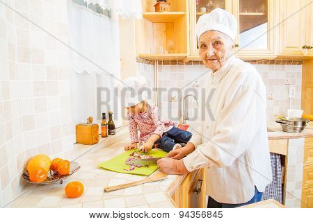 Grandma With Grandchild Cooking