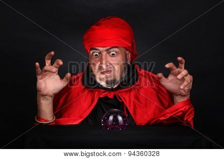 Soothsayer predicts future fortune telling using crystal ball