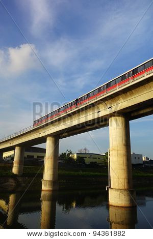 Singapore Mass Rapid Train (mrt) Travels On The Track