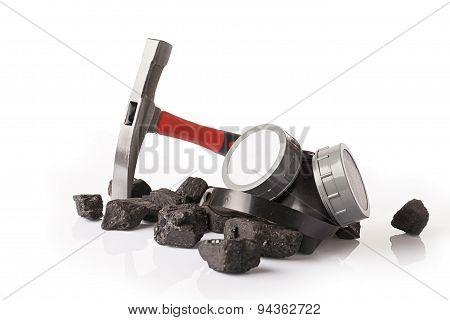 coal lumps  and protective ear muffs  isolated on a white background