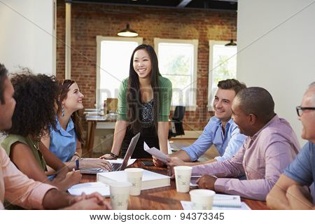 Female Boss Addressing Office Workers At Meeting