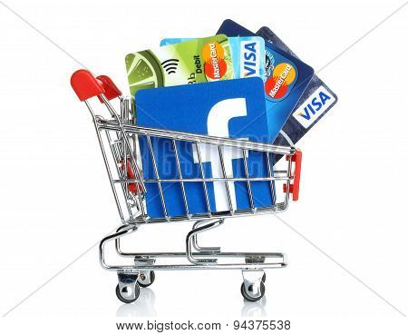 KIEV UKRAINE - MARCH 21 2015: Facebook logo printed on paper and placed into shopping cart with card