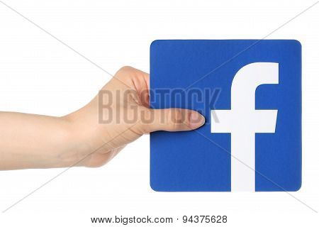 KIEV UKRAINE - APRIL 30 2015: Hand holds facebook logo