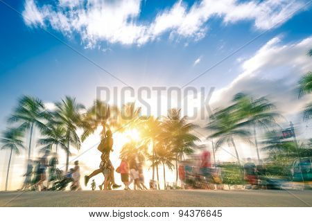 Man Running Through The Crowd At Sunset On Kalakawa Ave - Front Walk Promenade Of Waikiki Beach