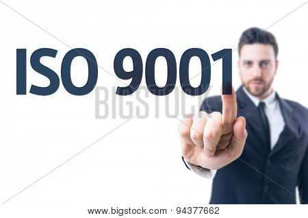 Business man pointing the text: Iso 9001