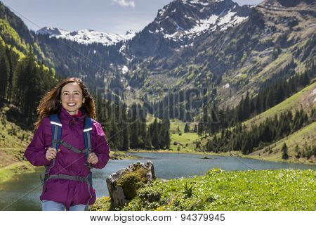 Woman Hiking By Lake
