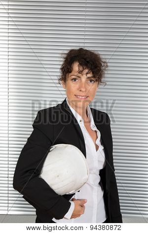 Portrait Of A Female Foreman During A Meeting About A Build Project
