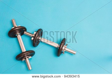 Two Dumbbellls Resting