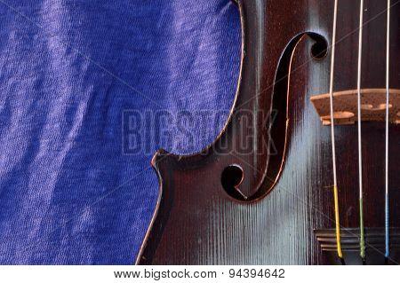 Antique Violin And Blue Linen Closeup