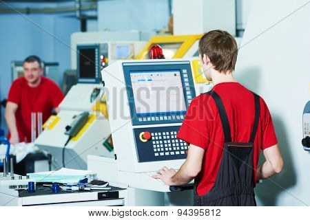 mechanical industrial worker at milling machine center in tool manufacture workshop