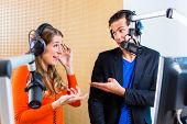 Presenters or moderators - man and woman - in radio station hosting show for radio live in Studio poster