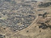 aerial view of low cost urban housing in Africa poster