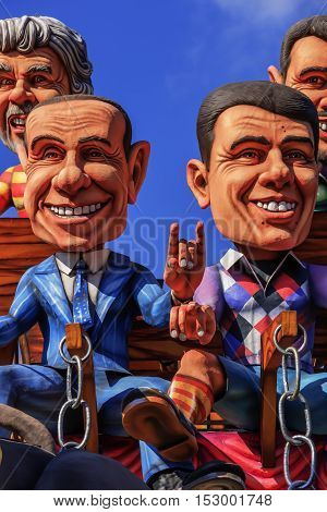 Putignano,Apulia,Italy - February 15, 2015: carnival floats, giant paper mache.Giants italian politicians: Silvio Berlusconi and Matteo Renzi.Carnival. Italian politicians: superstitious gestures..