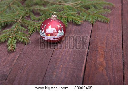 Christmas decorationtree with ball on wooden background.