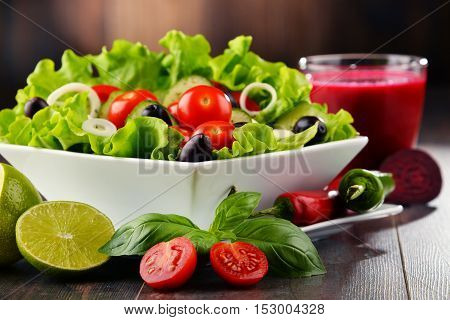 Composition With Vegetable Salad Bowl And Glass Of Juice