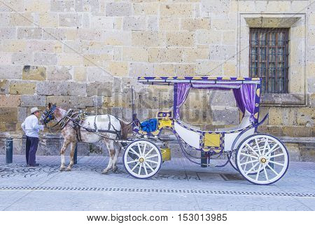 GUADALAJARA MEXICO - AUG 29 : Horse drawn wagon in Guadalajara Mexico on August 29 2016. Guadalajara is the capital and largest city of the Mexican state of Jalisco