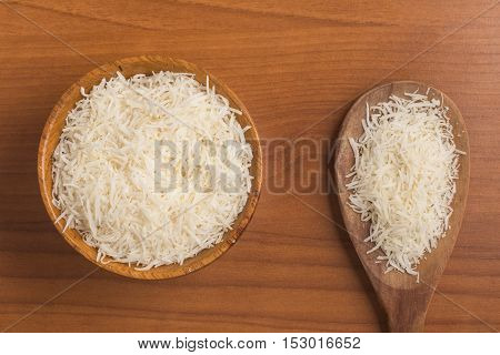 Dried Grated coconut over a wooden table