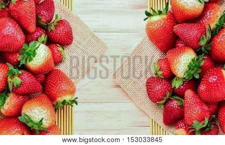 Strawberry on a wooden background top view