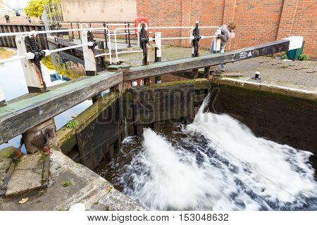 NOTTINGHAM ENGLAND - OCTOBER 19: A woman operating a pound lock at Nottingham Canal. In Nottingham England. On 19th October 2016.