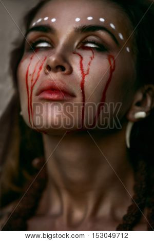Portrait of a witch crying with a tear of blood