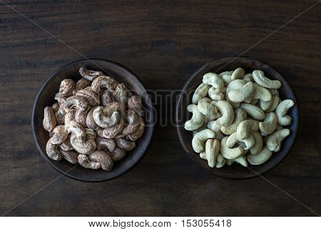 Fine quality cashew nuts filled in bowls. Roasted and cleaned cashew nuts placed side by side on rustic background.