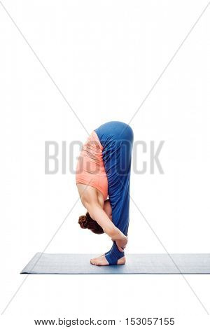 Woman doing Ashtanga Vinyasa Yoga Surya Namaskar Sun Salutation asana uttanasana - standing forward bend pose posture isolated on white background