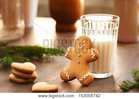 Homemade cookies for the feast of Santa Claus . Glass of milk and gingerbread man waiting for Christmas night. Sweets, xmas, new year concept