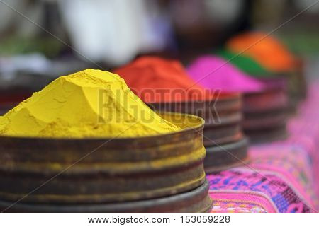 Bright color paint is sold at peruvian market